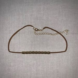 Gold and leather choker necklace